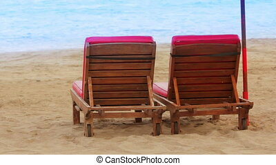 two sunbed on beach