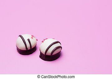 praline - two sweet pralines on a violet background
