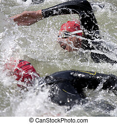 two swimmers at the start of a triathlon