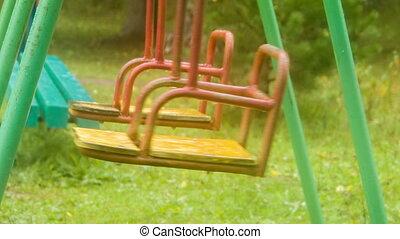 Two swing shakes on playground like pendulum - Two swing...