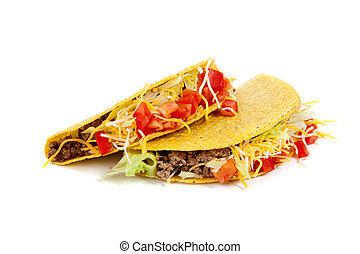 Two tacos on a white background with tomatoes, beef, lettuce...