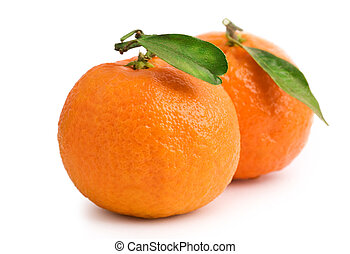 two tangerine with leaves