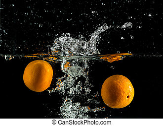 Two tangerines in water