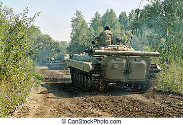Two tanks in motion on country road