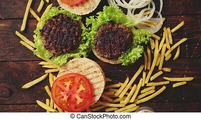 Two tasty grilled home made burgers with beef, tomato, onion...