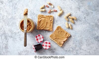 Two tasty peanut butter toasts placed on stone table. With...