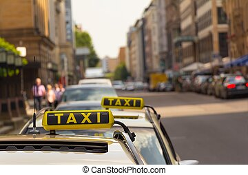 Two Taxis waiting at street for business in Berlin city