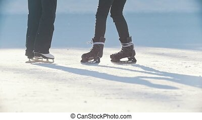 Two teen girlfriends learning to skate and having fun - legs...