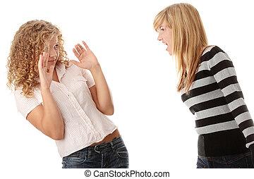 Two teen girls having an argue