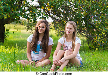 Two teen girls in the park