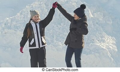Two teen girls skating and talking, slow-motion