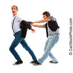 Two teenage boys having fun. Isolated on white