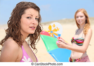 Two teenage girls at the beach