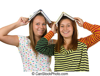 Two teenage girls fool around isolated on a white background