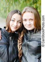 Two teenage girls having their long hair twisted - Two...