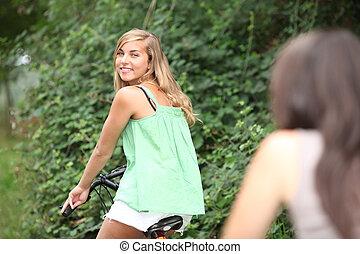 Two teenage girls on bike ride
