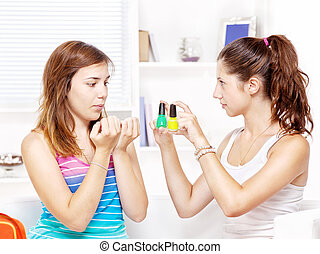 Two teenage girls polishing fingernails