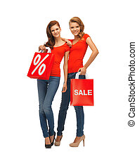 two teenage girls with shopping bags