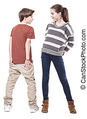 two teenager, male and female smiling at each other, isolated on white.
