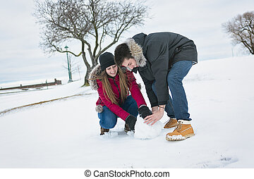 Two teenagers havinf fun on the snow field