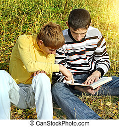 Two Teenagers with a Book