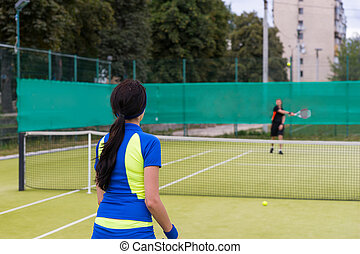 Two tennis players during the game