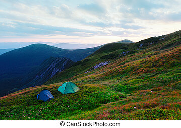 Two tents on autumn mountains