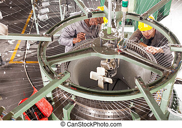 textile factory technician repairing