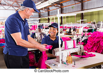 textile workers discussing work in factory