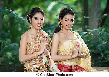 Two Thai woman wearing typical Thai dress, identity culture...