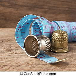 two thimble and measuring tape