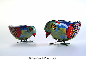 Two Tin Birds - Two old wind up tin toy birds.