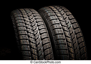 Two brand new car tires close up