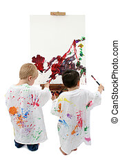 Two Toddler Boys Painting At Easel - Toddler boys in big...