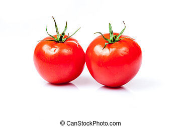 Two tomatoes isolated on a white background