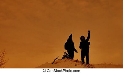 two tourist traveler Silhouette winter standing on a...