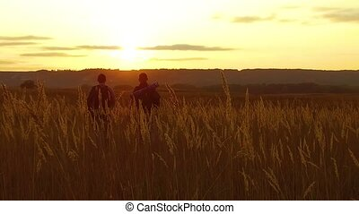 two tourists silhouettes. two tourists go at sunset. nature tourist silhouette nature slow motion video