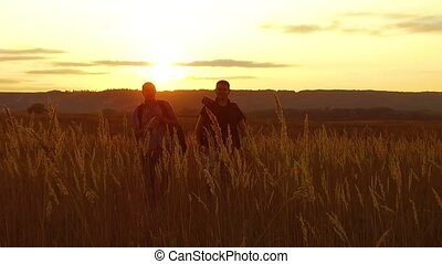 two tourists silhouettes. two tourists go nature at sunset. tourist silhouette nature slow motion video