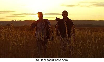 two tourists silhouettes. two tourists nature go at sunset. tourist silhouette nature slow motion video