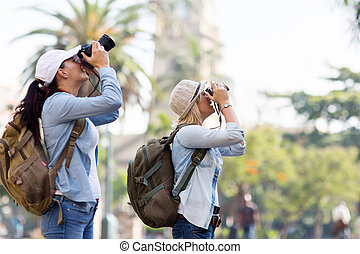 two tourists taking pictures