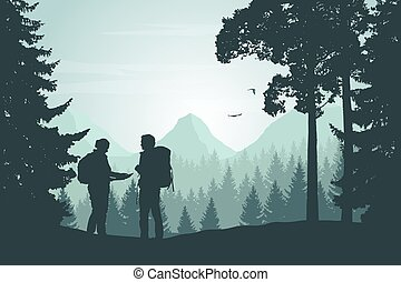 Two tourists walking through a mountain landscape with a forest looking for a path in the map under a winter sky with dawn