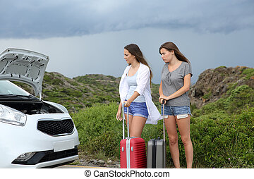 Two tourists with a breakdown car
