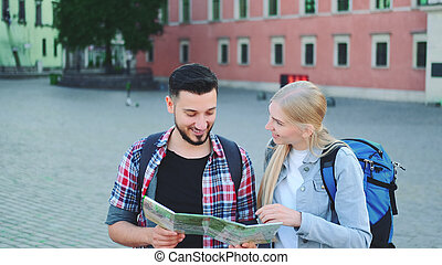Two tourists with map looking for new historical place in city center