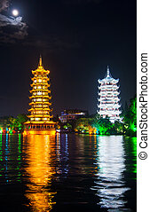 Two towers in Guilin in China with moonlight sky