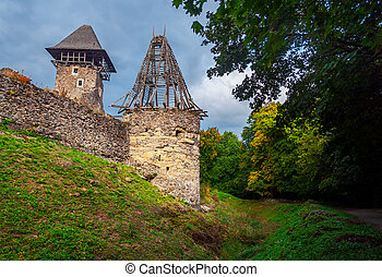two towers of Nevitsky castle. cloudy autumn weather. some...