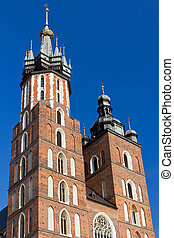 two towers of St. Mary's Basilica on main market sguare in cracow in poland on blue sky background