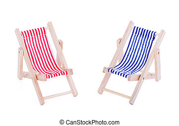 Two toy beach chairs over white backgroung