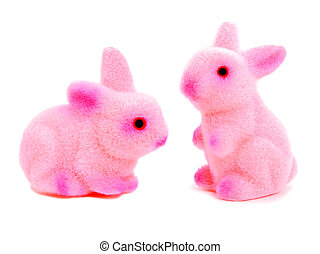 Two toy pink Easter bunnies isolated on white