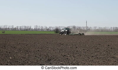 Two tractor with plow and drill - tractor with plow seeder...