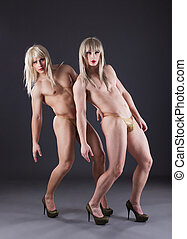 Two transvestites in heels - Full length portrait of two...